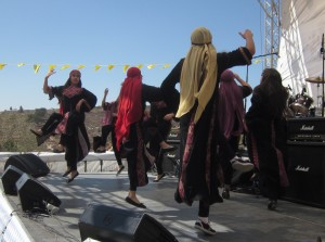 Young women danced to a Middle Eastern soundtrack.