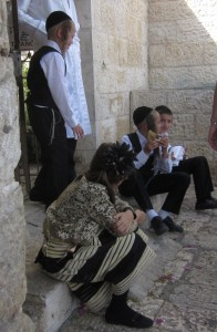 One boy was blowing on a shofar or ram's horn.