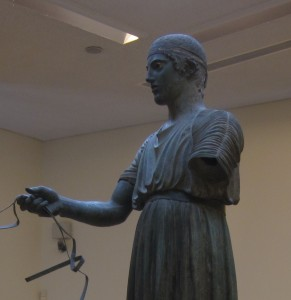 The charioteer's face reveals the Greek ideal.