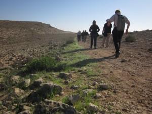 Hikers walk near Makhtesh Gadol.