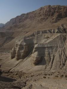 Cliffs loom over Qumran.